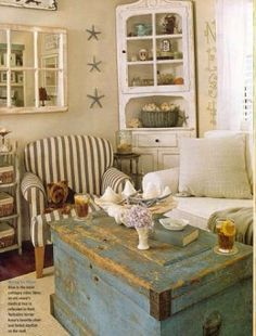 The antiqued coffee table is perfect for this beach house. It feels comfortable, light and airy.