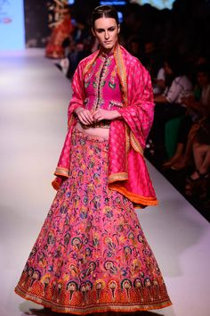 """""""Krishna Mehta  Featuring a fuschia silk blouse with floral embroidery. It comes along with fuschia silk lehenga with fully embroidered floral jaal and matching embellished dupatta in raw silk. COMPOSITION: Silk, raw silk."""" (quote)"""