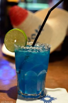 Island Margarita - Cuervo Tequila, Malibu Rum, Triple Sec, Blue Curacao, Lime Juice. could really go for one of these right now.