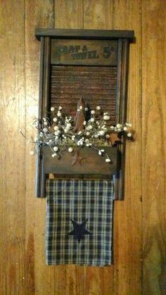 Primitive grungy washboard, with candle, pip berries, towel BOOTH #56 ELIZABETHTOWN KY #PrimitiveBathrooms #PrimitiveCountryDecorating