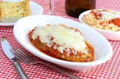 Traditional Italian-American Veal Parmigiana or Parmesan (Vitello alla Parmigiana)  | Enjoy this authentic Italian-American recipe from our kitchen to yours. Buon Appetito!