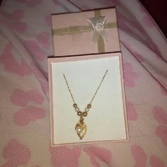 Gold and Pearl Necklace Real gold and pearls. Has been in my jewelry box for years but never wore it because it didn't fit. It truly is a beautiful piece, just not for me. Still in box. Jewelry Necklaces