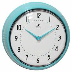 """Retro-style turquoise wall clock with bold numerals.   Product: Wall clockConstruction Material: MDF, metal and resinColor: Turquoise and white Accommodates: (1) AA Battery - not included Dimensions: 9"""" Diameter x 2.75"""" D"""