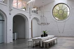 a former stable house has been converted into a photography studio, office space and living area on the top floor.