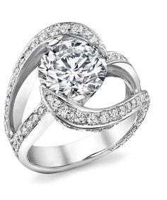 Platinum engagement ring featuring a 3.00ct center diamond and 2.50ctw of pave set diamonds.