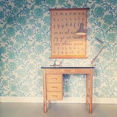Vintage penmanship poster and formica desk.
