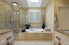 Sandstone tile on shower wall and floor