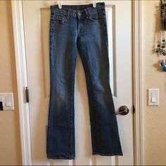 """7 For All Mankind Jeans 7 For All Mankind Bootcut Jeans. Made in America of Imported Fabric. Size: 24/00 Inseam: 33"""" 98% Cotton 2% Polyurethane. Super comfortable and light colored jeans. Bottoms are in a pretty good condition. 7 for all Mankind Pants Boot Cut & Flare"""