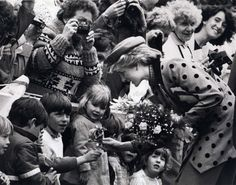 1986: Diana, Princess of Wales, greets onlookers on a visit to Victoria.  All the little children♡♥