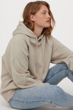 Wide top in sweatshirt fabric with a lined, drawstring hood, long raglan sleeves, kangaroo pocket and ribbing at the cuffs and hem. Cut Sweatshirts, Hooded Sweatshirts, Stylish Outfits, Fashion Outfits, Stylish Hoodies, Raglan, Fashion Company, Lady, Neue Trends
