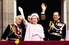 Earl Mountbatten of Burma, Queen Elizabeth II and the Duke of Edinburgh wave from the balcony of Buckingham Palace after the Silver Jubilee procession.