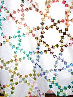 jack's chain: made with strip-pieced 9 patch blocks, hexagons and triangles! like a drunken irish chain