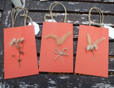 Three red paper gift bags decorated with by LilyPadsAndSunshine