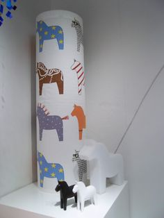 Dala Horses and Fabric. The fabric roll would make a cute table lamp.