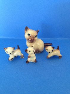 My sister had these in many animal forms. she collected 'em- I broke 'em!  Siamese Cat and Kitten Miniature Figurine HAGEN RENAKER