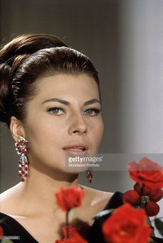 Princess of Iran Soraya (born Soraya Esfandiary-Bakhtiari), the second wife and Queen Consort of the late Shah of Iran, is posing in front of a piano in the elegant living-room of her villa, furnished in classic style, in the Appia Antica near Rome. Rome (Italy), 1964..