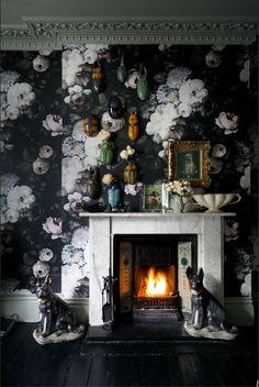 Glossy black floors and dark floral wallpaper. #designcrush Image: Livingetc