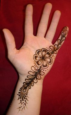 simple cute mehendi design for the left hand, traditional culture of applying henna on the hands and feet