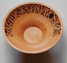 Wooden bowl with wonderful woodburned pattern.