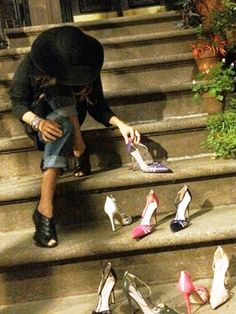 Carrie Bradshaw shoes: Sarah Jessica Parker posed her shoes on Carrie's iconic stoop! via @WhoWhatWear