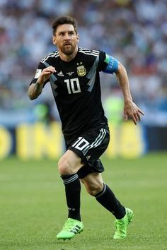 Lionel Messi Photos - Lionel Messi of Argentina runs during the 2018 FIFA World Cup Russia group D match between Argentina and Iceland at Spartak Stadium on June 16, 2018 in Moscow, Russia. - Argentina vs. Iceland: Group D - 2018 FIFA World Cup Russia