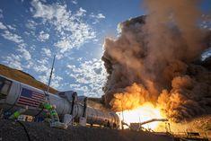 SLS Rocket booster horizontal on ground fires up for test.