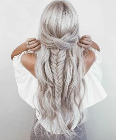 Take your style cue from *Frozen's* Elsa and incorporate a princess-like fish braid into your long platinum blonde hair
