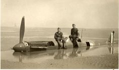 German troops pose with the wreck of P9374 during June 1940 on Calais beach. In the background is the Phare-de-Walde light tower, a landmark that helped to confirm that this photograph was of Flying Officer Peter Cazenove's Spitfire that he had landed here during May 1940