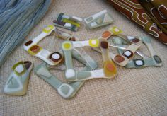 Fused glass buckles, brooches on Behance