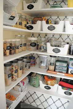 Beautifully Organized Pantry.  Next time I see those cool containers at the dollar store and wonder what I could do with them...this is the answer!