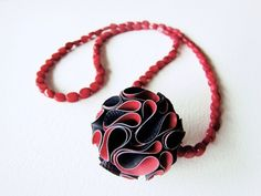 <b>Spheres</b><br /> Pendant<br /> Rubber handcut and handpainted, metal, coral beads<br /> 2009<br /> Photo: Niki Stylanou<br />