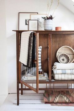 Retro Sideboard decor ideas to create a modern industrial and vintage hallway, using white plat pots and throws to accessorise.