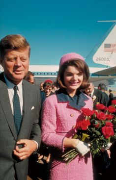 Jackie Kennedy in her iconic pink Chanel suit and pillbox hat, the day her husband President John F. Kennedy was assassinated in Love Field, Dallas, Texas, 1963.