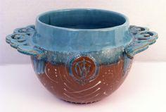 Open Casserole Dish  Wheel thrown, deep red stoneware, with aqua glaze, white slip trailed designs and carved handles.  (KiteStar Studio - Carolyn Coffey Wallace)