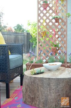 Use a giant tree stump as a coffee table for a unique tie-in for outdoor decor. It's a great conversation starter!