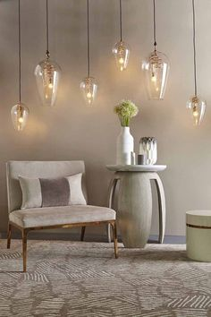 What a warm ambiance these hanging pendants create in this vignette with the side table and gorgeous armchair. Image by Houseology.