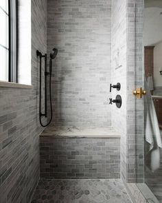 Chris Loves Julia's main bath is a perfect example of how featuring different shapes, sizes, and patterns within a single collection creates a stunning combination that's anything but boring 🖤 Design + Photography by Chris Loves Julia.  Tiles featured: Silver Mist Limestone. Bathroom Renos, Bathroom Renovations, Master Bathroom, Bathroom Ideas, Simple Human Mirror, Modern Cottage Bathrooms, Chris Loves Julia, Console Sink, Limestone Tile