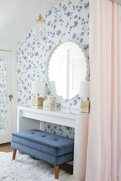 Pale blue floral wallpaper with blush accents