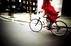 Little Red Riding Hood.  Love the coat, love the bike, love the movement in this photo.