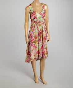 Pretty pleats and sweeping floral blooms keep this dress on-point for fair-weather soirees. Paired with a sleeveless silhouette that gives a pretty peek of sun-kissed shoulders, it's an endlessly satisfying pick.
