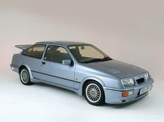 1986 Ford Sierra Cosworth At last, a Sierra to get excited about. The race tuned Cosworth, complete with its huge tail gate spoiler. Initially only available as a 3 door Ford Sierra, Ford Rs, Car Ford, Retro Cars, Vintage Cars, Ford Classic Cars, Ford Escort, Ford Motor Company, Sport Cars