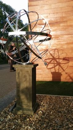 Stainless steel armillary on a @RedwoodStone plinth. A glorious combo.