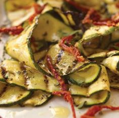 Marinated Grilled Zucchini with Oregano and Dried-Tomato Vinaigrette:  http://www.surlatable.com/product/REC-167243/Marinated-Grilled-Zucchini-with-Oregano-and-Dried-Tomato-Vinaigrette