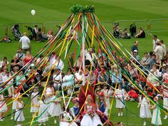 Maypole dancing -- such fun. It takes practice to get the ribbons to wind on the pole in a perfect pattern.