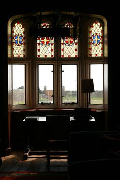 Leaded glass details are even found in the library, where a writing desk is positioned to overlook the view of The Grange's spacious lawn.