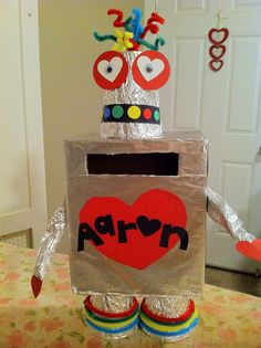 Valentines day card box feeder for my son. Unique Valentine Box Ideas, Valentines Card Holder, Valentines Robots, Valentine Boxes For School, Puppy Valentines, Valentines For Boys, Valentine Day Crafts, Printable Valentine, Homemade Valentines