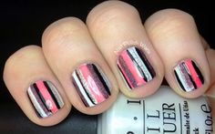 I then used my striping brush with Zoya Maya, a soft coral jelly, Layla Misty Blush, a plum holo, Kiss Black, and Kiss Silver to place random stripes down my nail