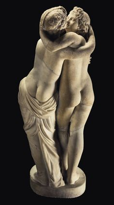 A delightful Roman marble Cupido (Eros) and Saiki embracing circa 1st century AD H. 78.4 cm