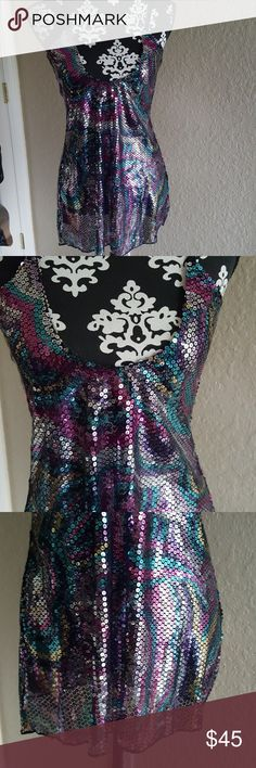 Free People Groovy Disco Mini Disco inspired Free People Intimately sequin dress in a swirl print. Very groovy!!! Wear it as a dress or tunic with some leggings. Relishing, unfortunately too small on me. Free People Dresses Mini