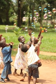 Beautiful children playing with bubbles